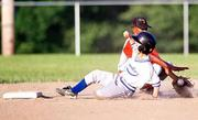 Hawks baserunner Travis Sanders safely slides into second base, beating Falcon Nathan Padia's tag. The 12-under teams battled in the first round of the postseason tournament as temperatures neared 100 degrees last week on the diamonds at the 4-H Fairgrounds.