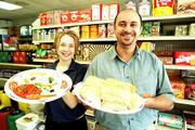 Spinach or cheese pies and a vegetarian plate featuring hummus, baba ghannooj and ajvar are among the fresh dishes presented by employee Liz Morel, left, and owner Mohammad Al-Zaiti at Mediterranean Market & Cafe, 3300 W. 15th St.