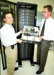 Mike Zheng, president of Microtech Computers Inc., and Bret Stouder, director of Atipa Technologies, recently shipped a $1 million supercomputer to Clemson University. The Lawrence company is making a similar, smaller system, above, for a lab in California.