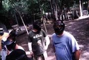 Seth Jones, center, learns the reasons for wearing protective headgear at a recent Drop Zone Paintball outing.