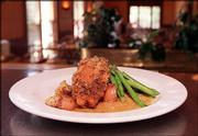 Chicken Marsala stuffed with feta cheese and pepronata, served with new potatoes and fresh green beans.