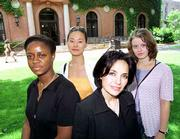 Charting a new course for women and money are Smith College professor Mahnaz Mahdavi, front right, and her three college interns: Rosy Fynn, left, Sungwoo Loo, and Dessislara Michaylova, of Bulgaria. For the first time, the elite women's college will offer classes this fall on the basics of money management.