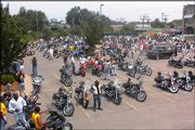 Riders assemble for the 2000 MDA ride at Topeka Harley-Davidson