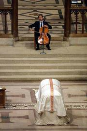 Cellist Yo Yo Ma performs during funeral services for Katharine Graham at the National Cathedral in Washington. Thousands of people paid tribute Monday to the late Washington Post publisher.