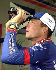 Overall Leader Lance Armstrong checks his glasses. Armstrong and the rest of the riders in the Tour de France took a rest day Monday in Pau, France.