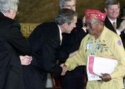 President Bush congratulates Navajo Code Talker John Brown. All 29 original Code Talkers only five are still living were awarded the Congressional Gold Medal for their heroic service in World War II.