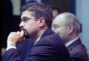 Bob L. Thomas, foreground, is the newly hired attorney for John E. Robinson, who is accused of so-called barrel slayings in Kansas and Missouri. Robinson, in the background at right, has hired Thomas, a lawyer who graduated about a year ago, to replace the team from the Kansas Death Penalty Defense Unit that has represented him for more than a year. A judge is considering whether Robinson should be allowed to go through with the change in counsel.