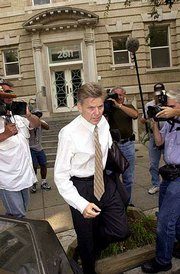 Rep. Gary Condit, D-Calif., is pursued by the media as he leaves his Washington apartment building. The family of missing intern Chandra Levy said Thursday that a civil lawsuit against Condit is being considered.