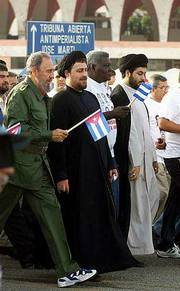 Cuban President Fidel Castro marches alongside Hassan Khomeini, grandson of the late Ayatollah Ruhollah Khomeini, in Havana to celebrate the start of the Cuban revolution nearly 50 years ago.