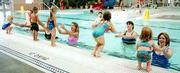 Three- and 4-year-olds participating in the parent/child swimming class jump into the arms of a parent at the Lawrence Indoor Aquatic Center. From left are: Holly Swearingen, 3, and her father, Rocky; Joshua Dreiling, 3, and his mother, Linda; Mckenzie Brungardt, 3, and her mother, Lori; instructor Larry Goltz; Kayla Lee, 4, and her mother, Angie, and Amber Draper, 3, and her mother, Sherry.