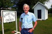 Gene Meade is shown in front of the one-room church he built on his property in Easton, Mo., July 5, 2001. At present the small, non-denominational church, is open 24-hours a day and measures eight feet by 12 feet.