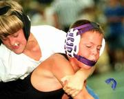 Jordan Brown of Pittsburg loses his mouthpiece as Gardner's Gregory Curtis makes his move during the Sunflower State Games. Brown defeated Curtis for third place in the 10-under boys 77-89-pound wrestling tournament Saturday at Free State High. More SSG coverage on page 3C.