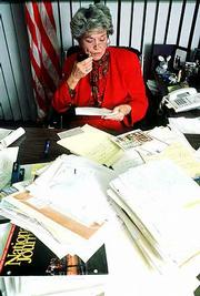 Former Kansas Gov. Joan Finney dictates responses to letters of congratulations on her gubernatorial victory in this file photo from 1990. Mrs. Finney, 76, died Saturday at St. Francis Hospital and Medical Center in Topeka.