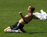 MLS East midfielder Jim Rooney imitates women's World Cup player Brandi Chastain by ripping off his shirt to reveal a sports bra as he drops to the ground in celebration. Rooney scored during the MLS All-Star Game, which ended in a 6-6 tie Saturday in San Jose, Calif.