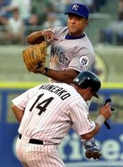 Chicago's Paul Konerko is forced at second by Kansas City's Luis Alicea. The Royals defeated the White Sox, 2-1, in 10 innings Tuesday night in Chicago.