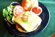 A hamburger topped with guacamole and salsa is an example of the many twists Molly McGee's, 2429 Iowa, puts on American cuisine.