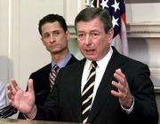 Atty. Gen. John Ashcroft announces steps to help states clear a large backlog of DNA genetic samples collected from criminals that could be used to help solve crimes. Ashcroft made the announcement at a news conference Wednesday at the Justice Department in Washington. Looking on behind Ashcroft is Rep. Anthony Weiner, D-NY.