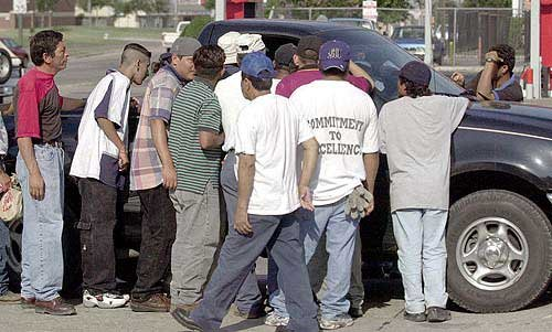 Photo Undocumented Mexican Immigrants Crowd Around A Construction Contractor Looking LJWorld