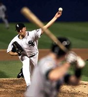 Chicago's Mark Buehrle delivers to Tampa Bay's John Flaherty. Buehrle allowed just one hit as the White Sox defeated the Devil Rays, 4-0.