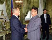 "Russian President Vladimir Putin, left, shakes hands with North Korean leader Kim Jong Ii Saturday during their meeting in Moscow. Kim signed a joint statement with the Russian President Vladimir Putin terming his missile program ""peaceful in nature"" and opposing U.S. plans for an anti-missile system to defend against countries like the Stalinist North Korea."