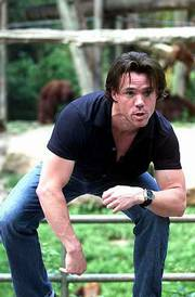 "Terry Notary, ape coach to the performers of the Hollywood movie ""Planet of the Apes"" mimics an ape at Singapore Zoological Gardens in Singapore. Notary, who is in Singapore Saturday to promote the movie, was charged with making Tim Burton&squot;s vision of a realistic ape planet come alive."