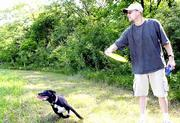 Burk Kitchen, and his dog, named Tori, have a new Lawrence park to play in. An opening ceremony for Mutt Run, an off-leash dog park, was Saturday. The park is located below the Clinton Dam at 1330 E. 901 Road.