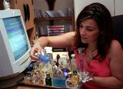 Baltimore waitress Joanna Bonicker has swapped her cosmetics for bottles of perfume such as these at the www.makeupalley.com Web site. Bonicker and others enjoy trading cosmetics online so they can try new products without spending a lot of money.