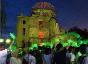The Atomic Bomb Dome is illuminated as demonstrators wave lights in Hiroshima, Japan, to commemorate the world's first atomic bomb attack. Today is the 56th anniversary of the attack.