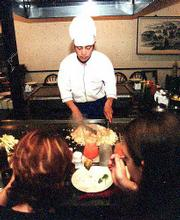 A chef provides tableside service at Kokoro, 601 Kasold Drive. The Japanese restaurant offers three different types of dining options.