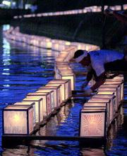 Paper lanterns are released on the Uragami River in Nagasaki, Japan, to carry prayers for the victims of the atomic bomb attack in 1945. The city marked the 56th anniversary of the atomic bombing on Thursday.