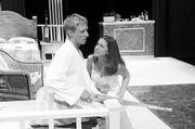 "Nathan Scholl, left, plays Brick, and Hannah Starks, plays Maggie, in Lawrence Community Theatre&squot;s production of ""Cat on a Hot Tin Roof"" last spring."