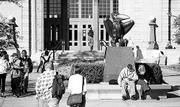 "Students take a break between classes near the bronze Jayhawk statue in front of Strong Hall. Kansas University Provost David Shulenburger called the past academic year one of ""extraordinary student accomplishment."" Students were honored for their achievements with Mellon fellowships and Truman scholarships."