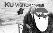 Margey Frederick, coordinator for Kansas University's Visitor Center, and one of the friendly mascots will greet thousands of visitors, prospective students and their families at the first Open House in early October.