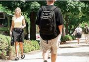 Despite all attempts at individuality, what's hot and what's not in fashion emerges on the typical college campus. At Kansas University, the standard dress for girls is a skirt and T-shirt, a tiny purse and flip-flops. For guys, the look is baggy shorts and similar footwear, below.
