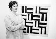 Mary Anne Jordan, Kansas University associate professor of design and director of graduate studies for the department of art and design, creates fiber works that are meant to be hung on the wall.