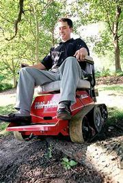 The Tracabout IRV 2000 can take wheelchair-bound individuals where they haven't gone before. Scott Swedlund of Tracabout takes the IRV for a spin over a stretch of grass and an exposed tree root.
