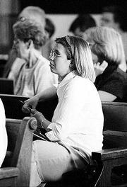 Kansas University senior Julia Gilmore listens to a discussion of congressional redistricting during a May 2001 meeting at the Douglas County Courthouse.