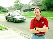 Mark Desetti and others living along Harvard Road want the Lawrence City Commission to slow traffic near their homes. Desetti is pictured in front of his house in the 4600 block of Harvard Road.