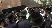 The casket of David Daskal is carried out of Shomrei Hadas Chapels in the Brooklyn borough of New York, after Daskal's funeral. Services were held Monday for Daskal and four other people killed Aug. 10 in a helicopter crash near the Grand Canyon's western end.