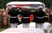 Marines prepare to place down the casket of one of 13 World War II Marines whose remains were discovered on a South Pacific island nearly 60 years after they fell in battle. The services Friday were conducted at Arlington National Cemetery.