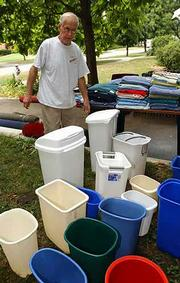 Orville Moorman's skill for turning trash into treasures has enabled him to make some money off the Kansas University moving season. He sorted through his inventory of wastebaskets Friday for his weekend yard sale at 1516 Mass.