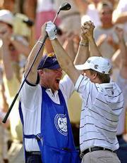 David Toms, right, and caddie Scott Gneiser celebrate after Toms aced the par-3 15th hole Saturday at Duluth, Ga.