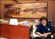 This Ernst Ulmer depiction of Quantrill's raiding party passing through Gardner, Kan., hangs in the First Kansas Bank in that small town near the Missouri border.