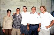 From left, Laura Bush, Aaron Beaver, Bobby Nichols, President George W. Bush and Dave Dearth embrace at the Jefferson Memorial in Washington, D.C., at the end of Casey's Ride.