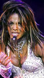 Janet Jackson performs in Kansas City, Mo., in this July 14 file photo. High ticket prices are keeping many fans away from the concert circuit this summer; tickets are still available for Jackson's shows this week at Madison Square Garden in New York.