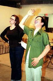 "Actors Kitty Steffens, left, and Kris Ariel rehearse a scene from ""A Day in My Life,"" a comedy sketch by the spoof troupe the Gay-2-Bees for Card Table Theatre&squot;s presentation of ""Victor&squot;s Vault The Best of the Victor Continental Show."" The show is at 10 p.m. Friday and Saturday at Liberty Hall."