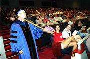 Stephen H. Grabow, Kansas University Marshal, leads the way down the aisle with the ceremonial mace. KU's 136th opening convocation welcomed students to the 2001-2002 academic year Wednesday at the Lied Center.