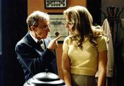 "Woody Allen, left, bumps heads with Helen Hunt in ""The Curse of the Jade Scorpion."""