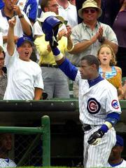 Cubs slugger Sammy Sosa, right, smacked three home runs in Chicago's 16-3 rout of Milwaukee. See page 4C.
