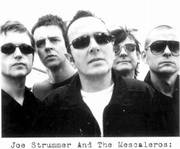 Joe Strummer, center, is surrounded by his new band, The Mescaleros.